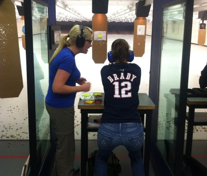 Instructor Lindsey working 1-1 with a new shooter