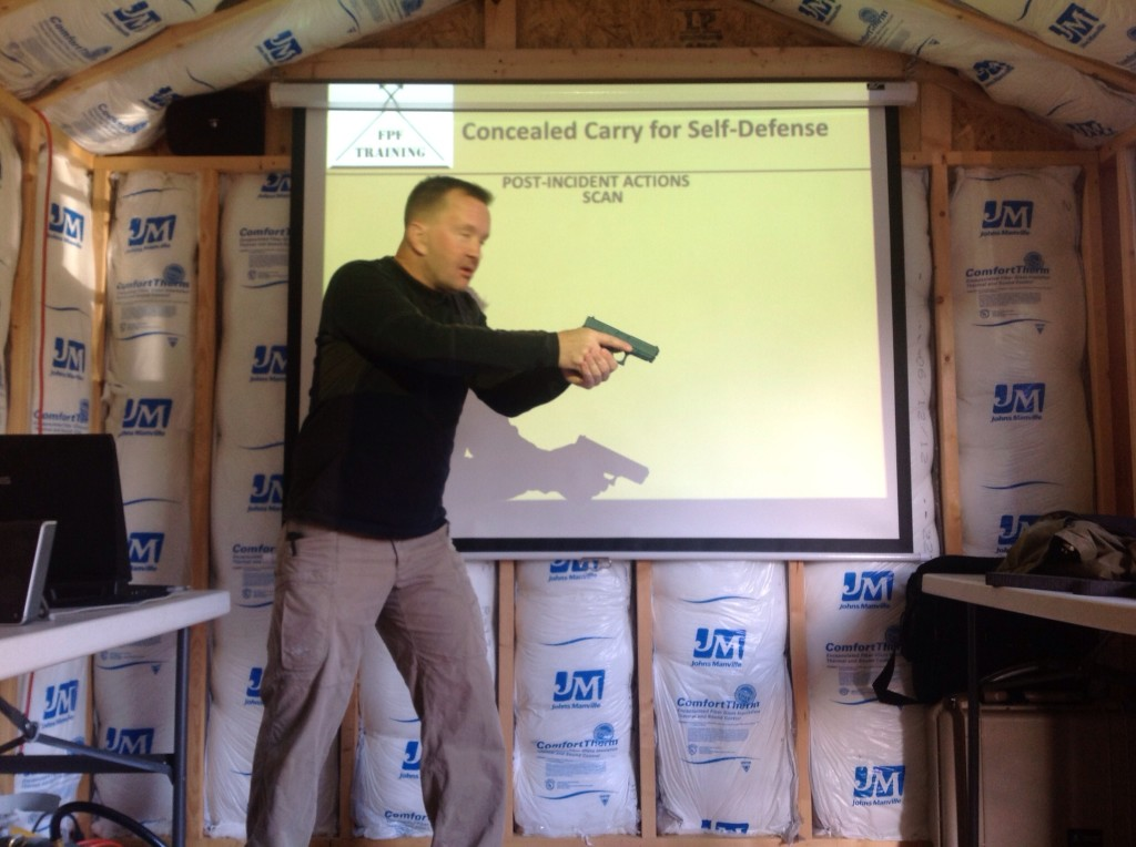 Instructor John discusses safe gun handling before we hit the range