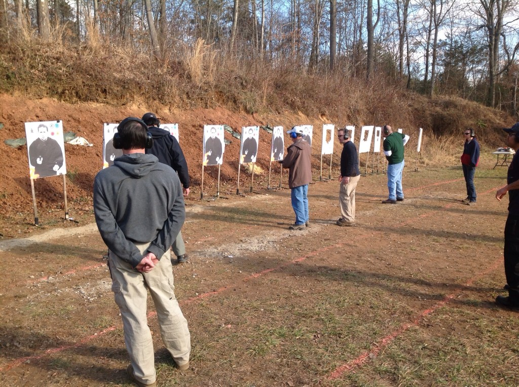 Students prepare for the gun class on line firing line